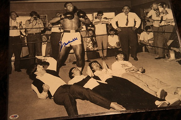 A 16\20 rare copy of Muhammad Ali with The Beattles signed by the Champ it includes a letter of Authenticity