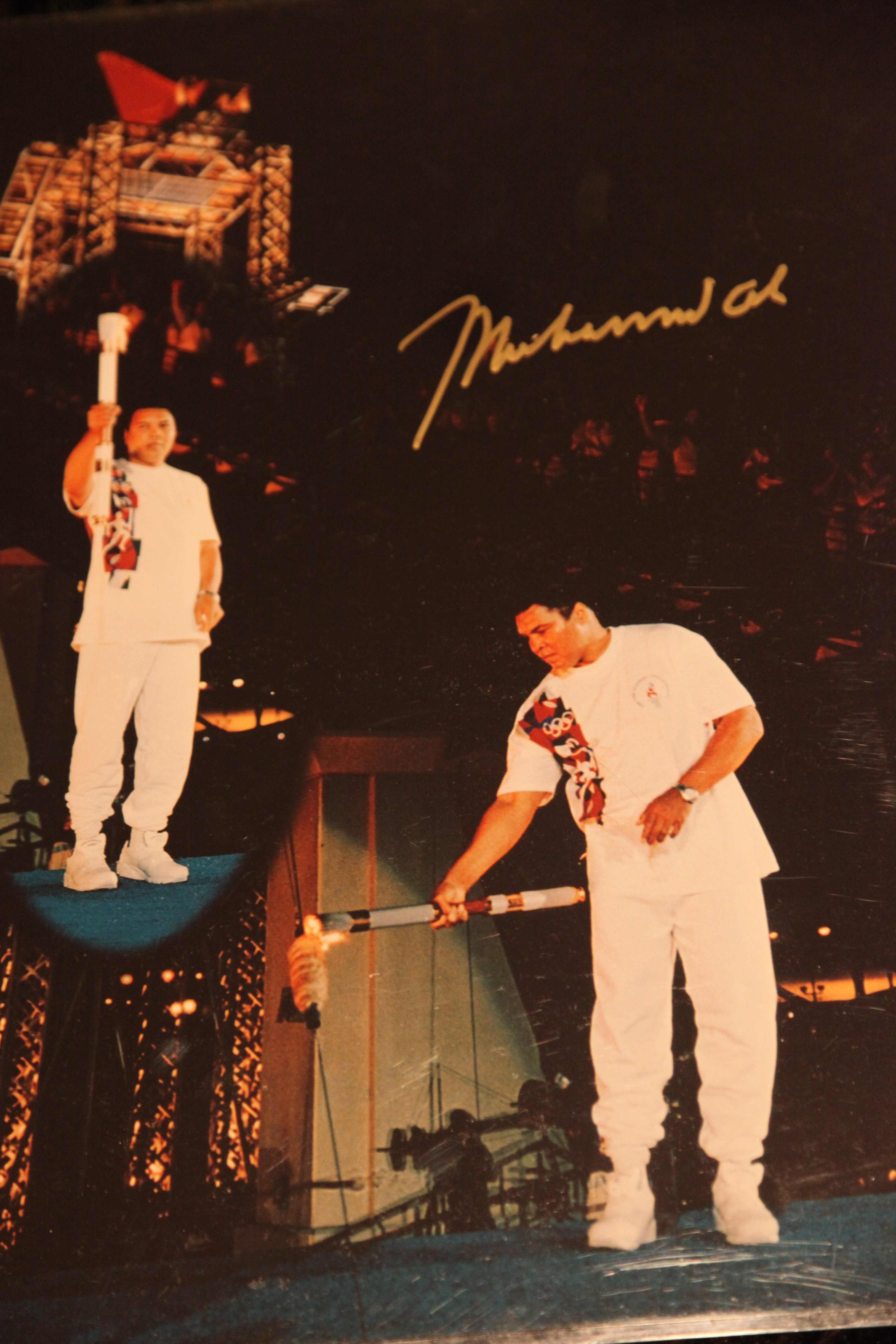 Signed 16x20 mint condition copy of Muhammad Ali lighting the Olympic Torch at the 1996 Olympic Ceremony in Atlanta